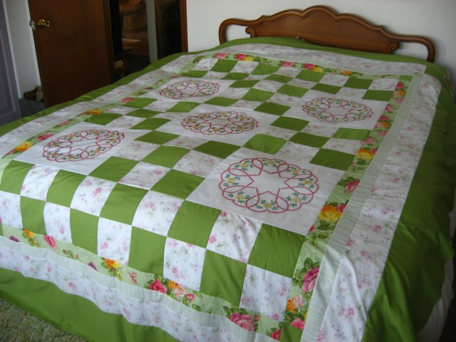 Quilt top with embroidery blocks